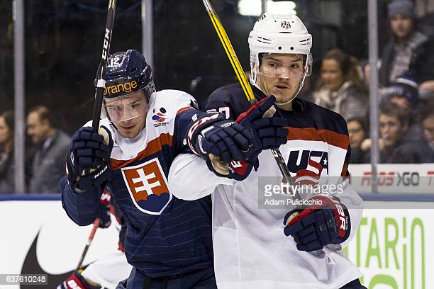 Forward Marian Studenic of Team Slovakia and Forward Jack Roslovic of Team United States become tied up behind the Team United States net in a...