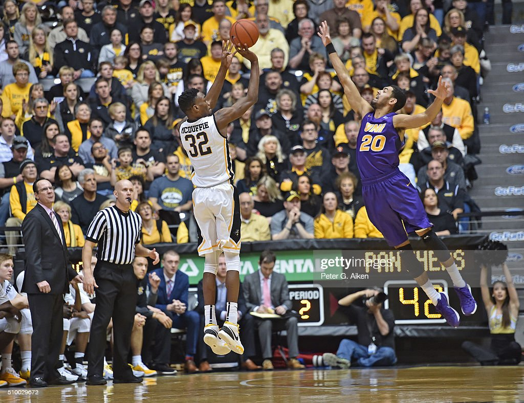 Forward Markis McDuffie #32 of the Wichita State Shockers puts up a three-point shot over guard Jeremy Morgan #20 of the Northern Iowa Panthers during the second half on February 13, 2016 at Charles Koch Arena in Wichita, Kansas. Northern Iowa defeated Wichita State 53-50.