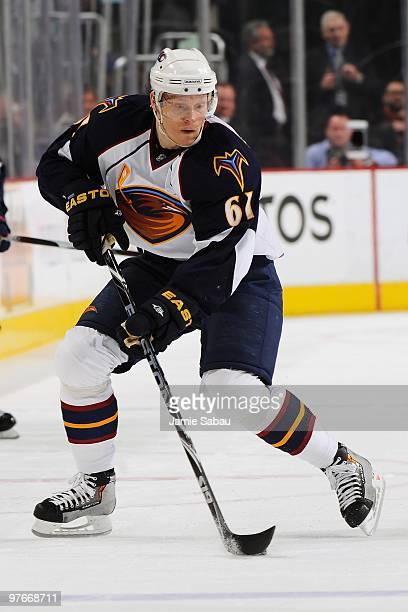 Forward Maxim Afinogenov of the Atlanta Thrashers skates with the puck against the Columbus Blue Jackets on March 11 2010 at Nationwide Arena in...