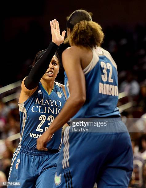 Forward Maya Moore and forward Rebekkah Brunson of the Minnesota Lynx celebrate a basket against the Los Angeles Sparks in game three of the 2016...