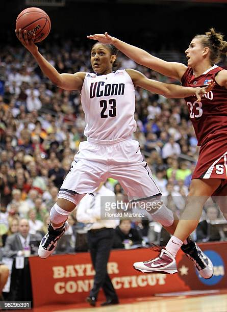 Forward Maya Moore of the Connecticut Huskies takes a shot against Jeanette Pohlen of the Stanford Cardinal during the NCAA Women's Final Four...