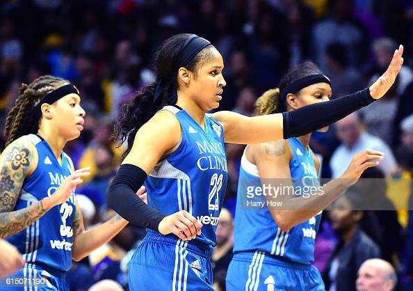 Forward Maya Moore of the Minnesota Lynx celebrates as she leaves the floor with her team leading the Los Angeles Sparks in the fourth quarter at...