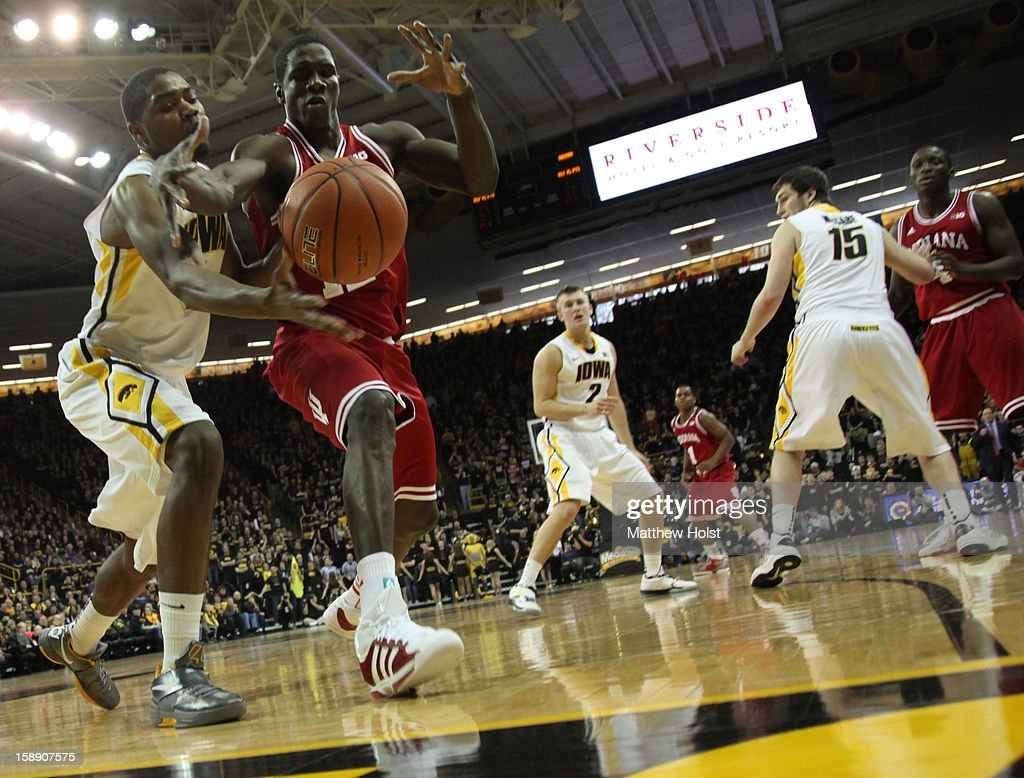 Forward Melsahn Basabe #1 of the Iowa Hawkeyes battles for the ball during the first half against forward Hanner Mosquera-Perea #12 of the Indiana Hoosiers on December 31, 2012 at Carver-Hawkeye Arena in Iowa City, Iowa. Indiana won 69-65.