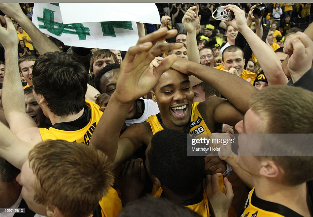 Forward Melsahn Basabe #1 of the Iowa Hawkeyes celebrates with fans after the match-up against the Wisconsin Badgers on January 19, 2013 at Carver-Hawkeye Arena in Iowa City, Iowa. Iowa won 70-66.