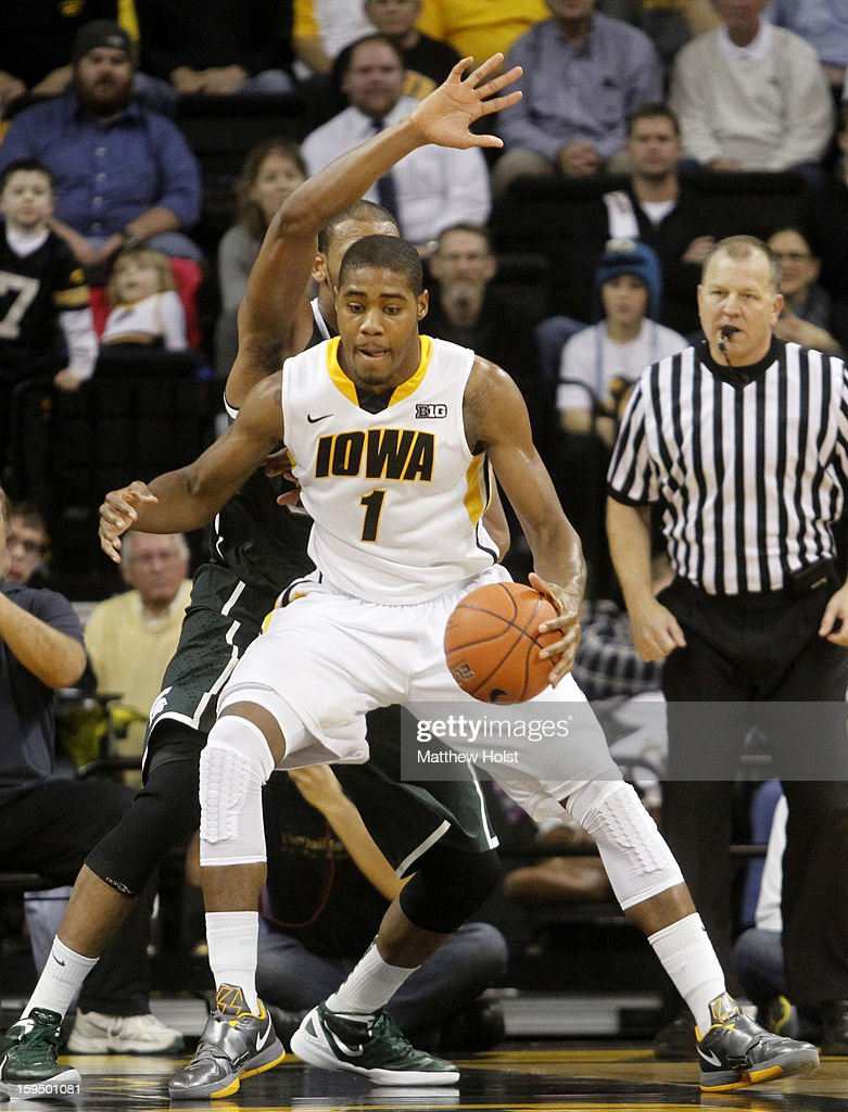 Forward Melsahn Basabe #1 of the Iowa Hawkeyes drives to the basket during the second half against center Adreian Payne #5 of the Michigan State Spartans on January 10, 2013 at Carver-Hawkeye Arena in Iowa City, Iowa. Michigan State won 62-59.