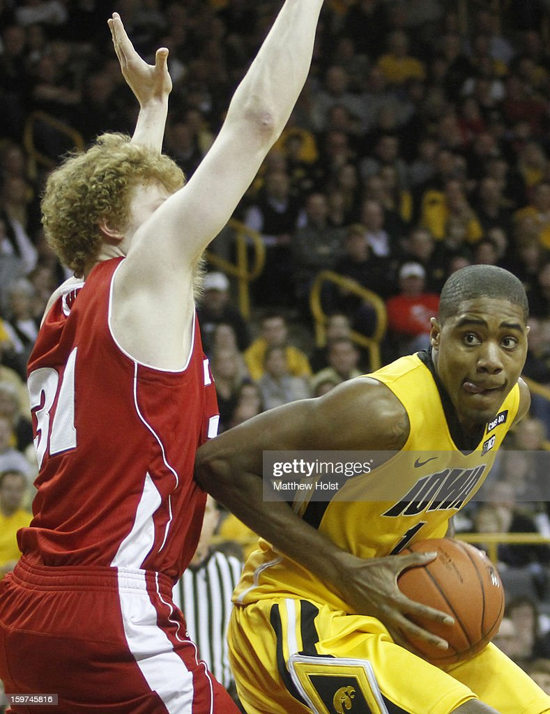 Forward Melsahn Basabe #1 of the Iowa Hawkeyes drives to the basket during the second half against forward Mike Bruesewitz #31 of the Wisconsin Badgers on January 19, 2013 at Carver-Hawkeye Arena in Iowa City, Iowa. Iowa won 70-66.
