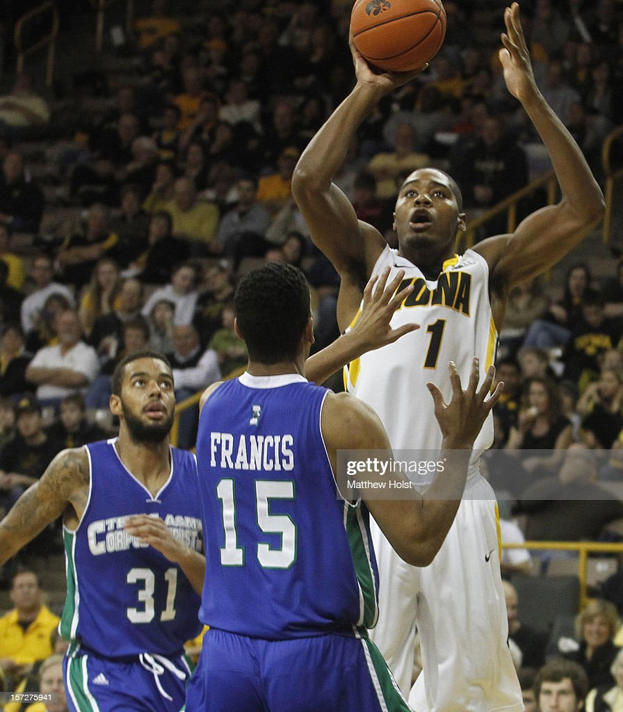 Forward Melsahn Basabe #1 of the Iowa Hawkeyes takes a shot during the second half in front of forward Dale Francis #15 of the Texas A&M Corpus Christi Islanders on December 1, 2012 at Carver-Hawkeye Arena in Iowa City, Iowa. Iowa defeated Texas A&M Corpus Christi 88-59.