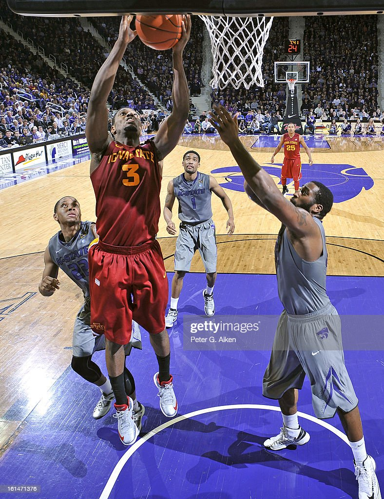 Forward Melvin Ejim #3 of the Iowa State Cyclones drives to the basket against forward Thomas Gipson #42 of the Kansas State Wildcats during the second half on February 9, 2013 at Bramlage Coliseum in Manhattan, Kansas.