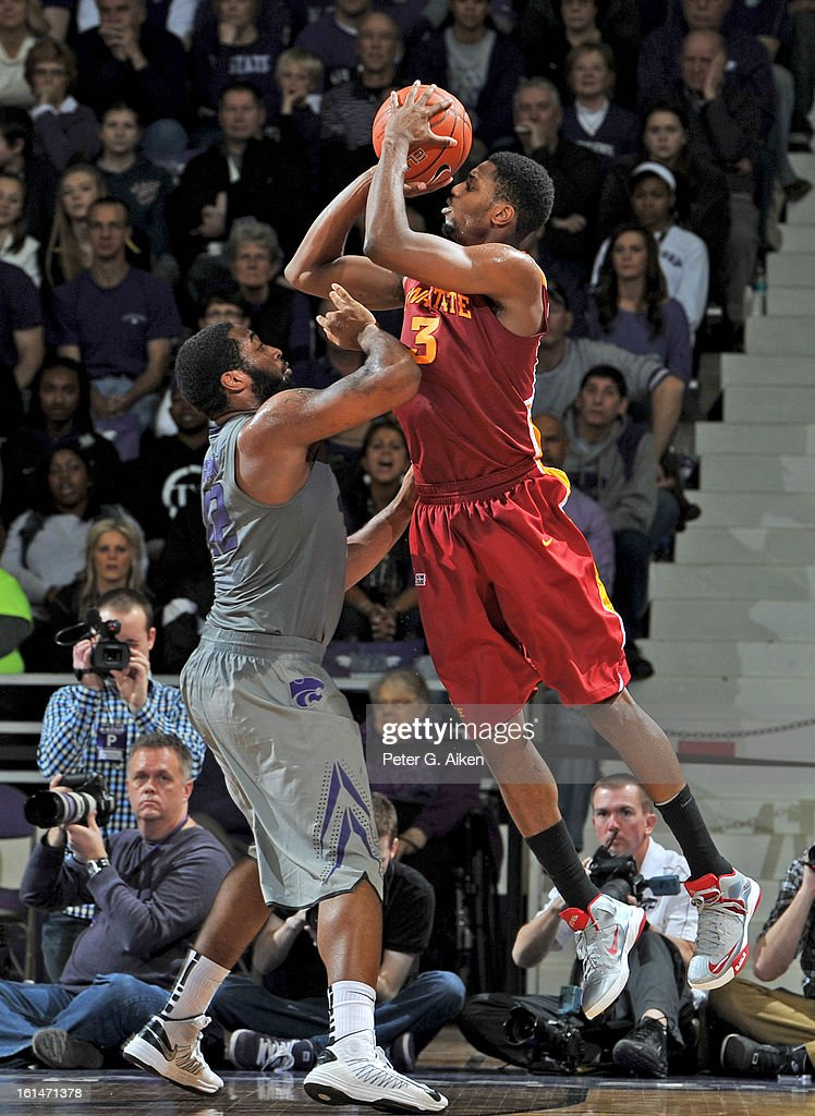 Forward Melvin Ejim #3 of the Iowa State Cyclones puts up a shot against forward Thomas Gipson #42 of the Kansas State Wildcats during the second half on February 9, 2013 at Bramlage Coliseum in Manhattan, Kansas.
