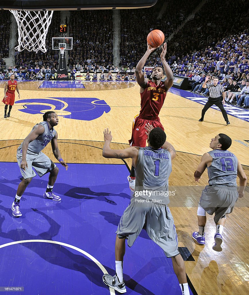 Forward Melvin Ejim #3 of the Iowa State Cyclones puts up a shot over defenders Shane Southwell #1 and Angel Rodriguez #13 of the Kansas State Wildcats during the second half on February 9, 2013 at Bramlage Coliseum in Manhattan, Kansas.