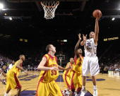 Forward Michael Beasley of the Kansas State Wildcats scores over defenders Craig Brackins and Jiri Hubalek of the Iowa State Cyclones in the second...