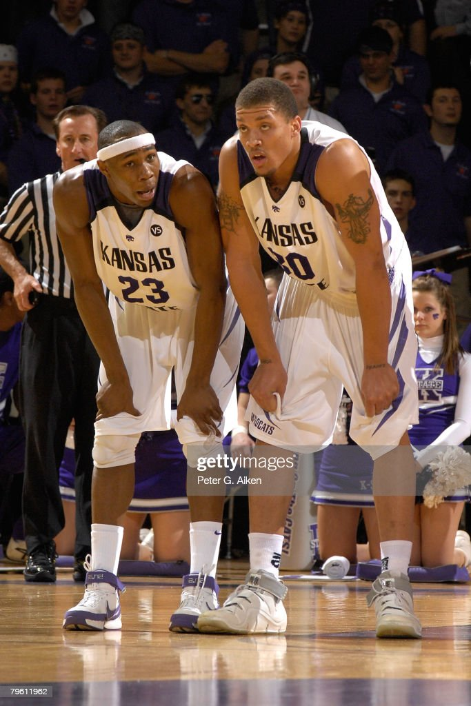 Forward Michael Beasley #30 of the Kansas State Wildcats talks with teammate guard Dominique Sutton #23 during a brake in the action against the Nebraska Cornhuskers in the first half of an NCAA Basketball game on February 6, 2008 at Bramlage Coliseum in Manhattan, Kansas. Kansas State defeated Nebraska 74-59.