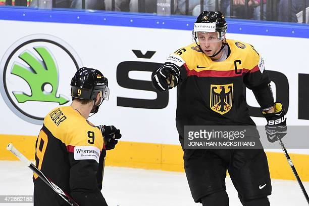 Forward Michael Wolf of Germany celebrates with his teammate forward Tobias Rieder after scoring a goal during the group A preliminary round match...