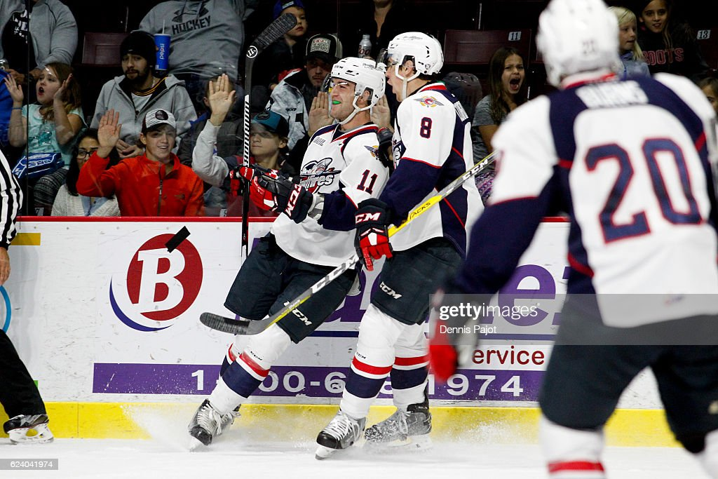Forward Mike Baird #11 of the Windsor Spitfires celebrates his goal at 10:44 of the second period against the Owen Sound Attack on November 17, 2016 at the WFCU Centre in Windsor, Ontario, Canada.