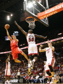 Forward Mike Miller and Joel Anthony of the Miami Heat defend against gurad Kevin Martin of the Houston Rockets at American Airlines Arena on March...