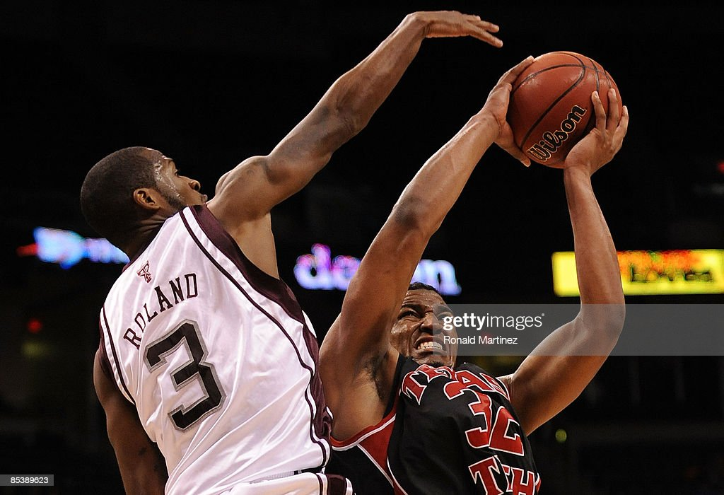 Forward Mike Singletary #32 of the Texas Tech Red Raiders takes a shot against Derrick Roland #3 of the Texas A&M Aggies during the Phillips 66 Big 12 Men's Basketball Championship at the Ford Center March 11, 2009 in Oklahoma City, Oklahoma. Singletary scored 43 points for a new Big 12 tournament record.