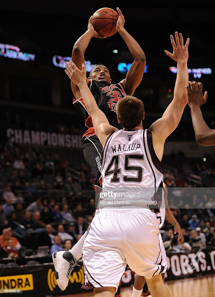 Forward Mike Singletary #32 of the Texas Tech Red Raiders takes a shot against Nathan Walkup #45 of the Texas A&M Aggies during the Phillips 66 Big 12 Men's Basketball Championship at the Ford Center March 11, 2009 in Oklahoma City, Oklahoma. Singletary scored 43 points for a new Big 12 tournament record.