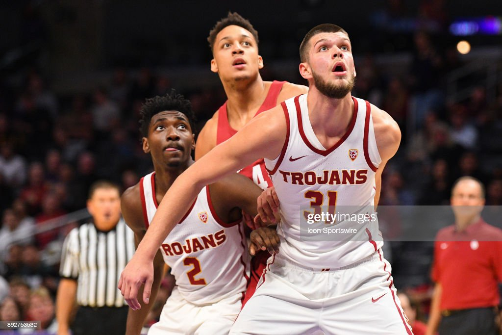 USC forward Nick Rakocevic (31) boxes out Oklahoma center Jamuni McNeace (4) and USC guard Jonah Mathews (2) during an college basketball game between the Oklahoma Sooners and the USC Trojans in the Basketball Hall of Fame Classic on December 8, 2017 at STAPLES Center in Los Angeles, CA.