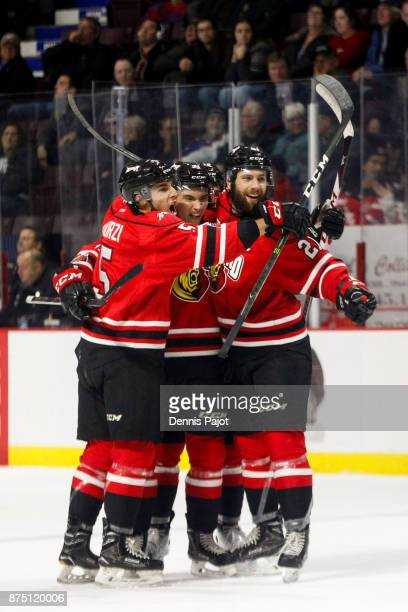Forward Nick Suzuki of the Owen Sound Attack celebrates his third period game winning goal against the Windsor Spitfires on November 16 2017 at the...