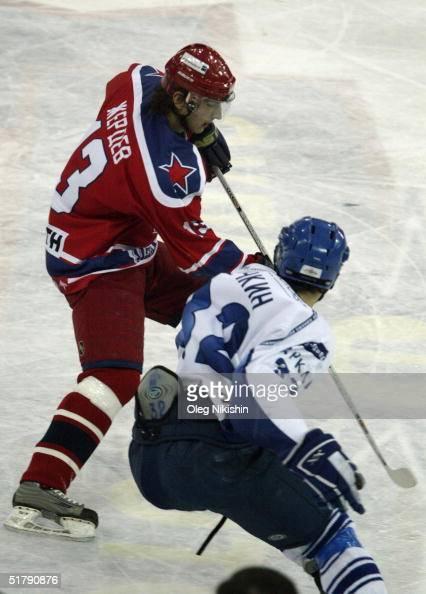 Forward Nikolai Zherdev of CSKA Moscow skates against forward Alexander Ovechkin of Dynamo Moscow on November 24 2004 at Luzhniki Ice Arena in Moscow...