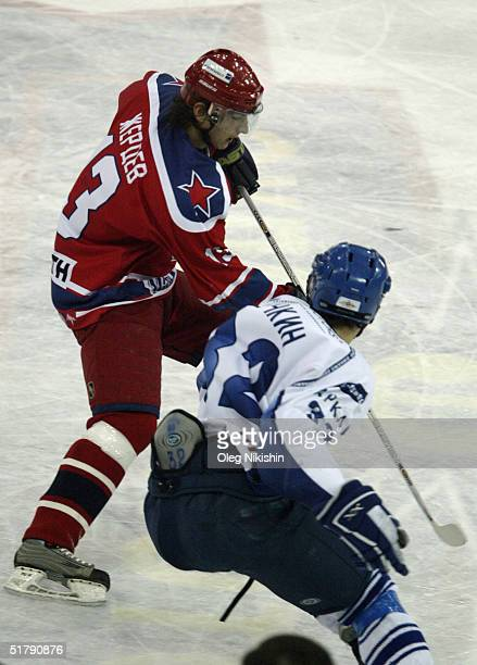 Forward Nikolai Zherdev of CSKA Moscow skates against forward Alexander Ovechkin of Dynamo Moscow on November 24 2004 at Luzhniki Ice Arena in Moscow...