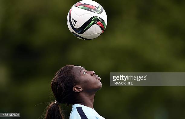 Forward of the French national women's football team Viviane Asseyi heads a ball during a training session in ClairefontaineenYvelines Suburban Paris...