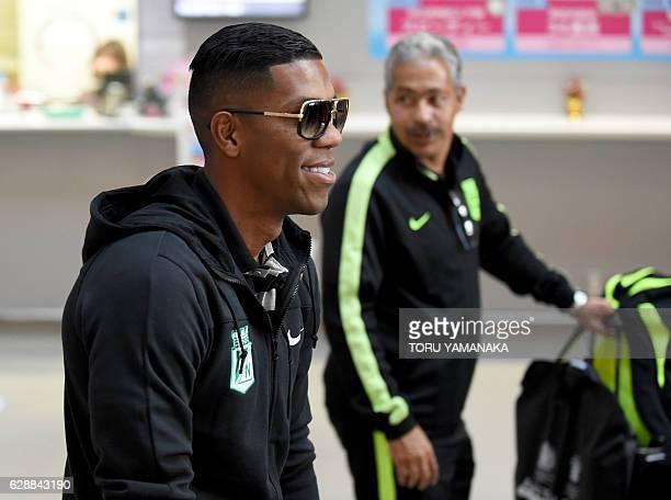Forward Orlando Berrio and a team staff of Colombian football club Atletico Nacional arrive at Kansai Airport in Izumisano Osaka prefecture to play...