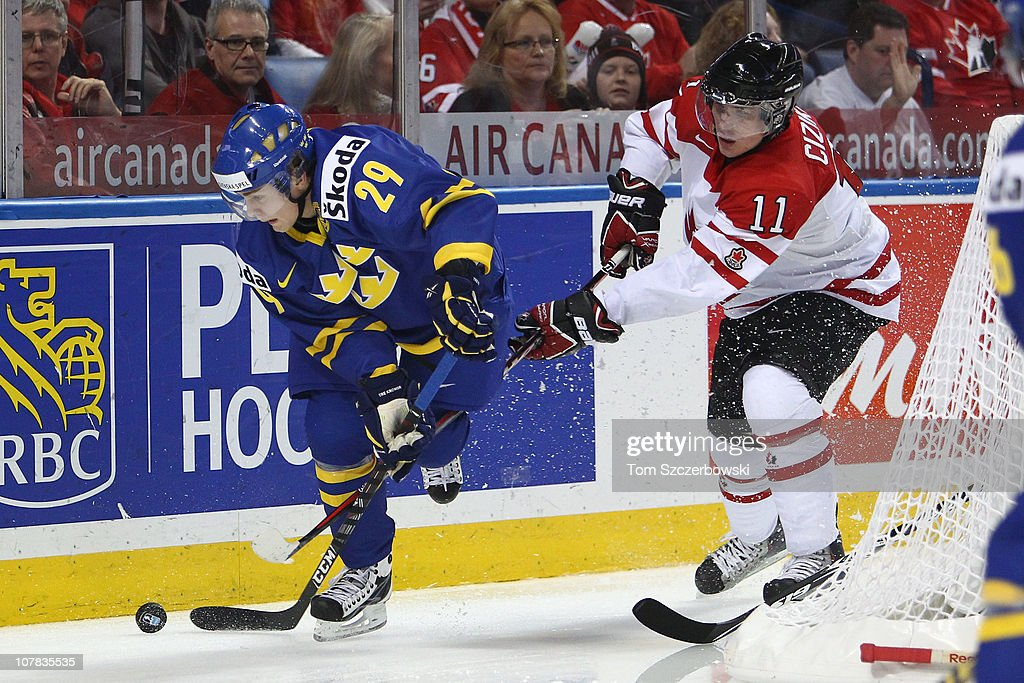 Forward Patrick Cehlin #29 of Sweden tries to get away from forward Casey Cizikas #11 of Canada during the 2011 IIHF World U20 Championship game between Canada and Sweden on December 31, 2010 at HSBC Arena in Buffalo, New York.