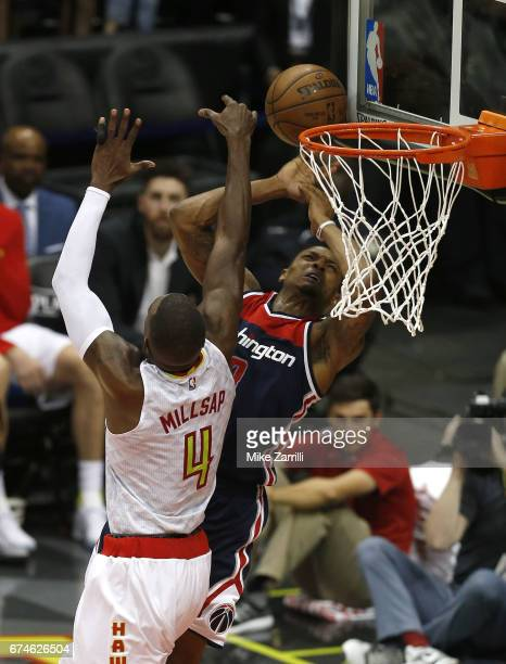 Forward Paul Millsap of the Atlanta Hawks blocks a shot by guard Brandon Beal of the Washington Wizards during Game Six of the Eastern Conference...