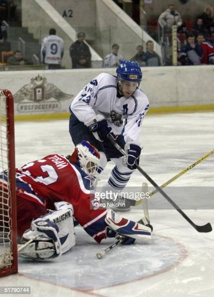 Forward Pavel Datsyuk of Dynamo Moscow skates to the crease against goaltender Jiri Trvaj of CSKA Moscow on November 24 2004 at Luzhniki Ice Arena in...