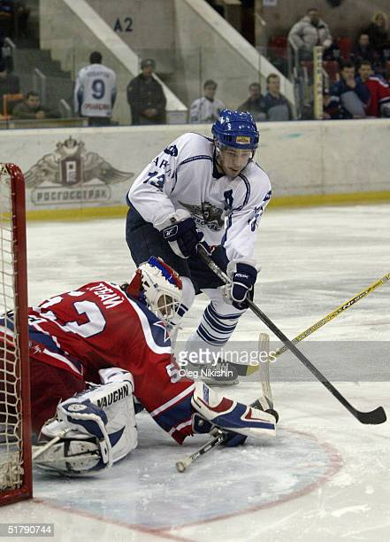 Forward Pavel Datsyuk of Dynamo Moscow skates to the crease against goaltender Jiri Trvaj of CSKA Moscow on November 24 2004 at Luzhniki Ice Arena in...