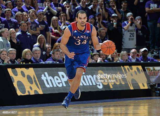 Forward Perry Ellis of the Kansas Jayhawks brings the ball up court against the Kansas State Wildcats during the first half on February 10 2014 at...