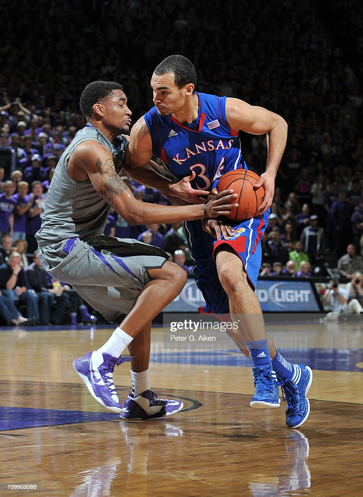 Forward Perry Ellis #34 of the Kansas Jayhawks drives against guard Shane Southwell of the Kansas State Wildcats during the first half on January 22, 2013 at Bramlage Coliseum in Manhattan, Kansas. Kansas defeated Kansas State 59-55.