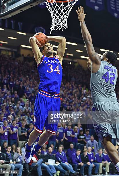 Forward Perry Ellis of the Kansas Jayhawks drives in for a dunk against forward Thomas Gipson of the Kansas State Wildcats during the first half on...