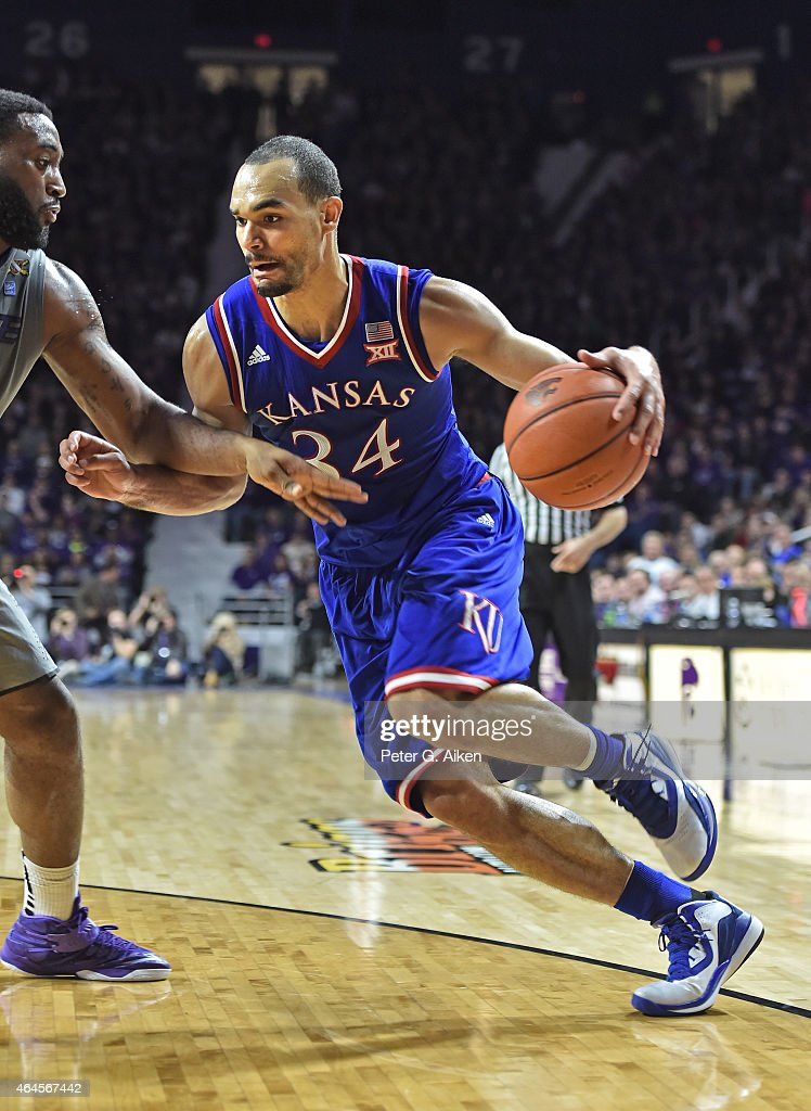 Forward Perry Ellis of the Kansas Jayhawks drives with the ball against forward Thomas Gipson of the Kansas State Wildcats during the first half on...
