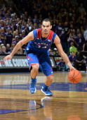 Forward Perry Ellis of the Kansas Jayhawks drives with the ball against the Kansas State Wildcats during the first half on February 10 2014 at...