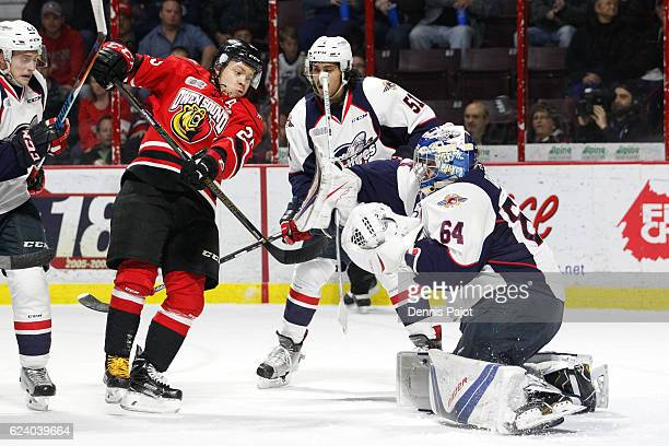 Forward Petrus Palmu of the Owen Sound Attack battles for the puck against goaltender Michael DiPietro of the Windsor Spitfires on November 17 2016...