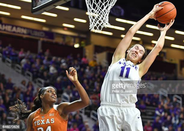 Forward Peyton Williams of the Kansas State Wildcats pulls down a rebound over forward Joyner Holmes of the Texas Longhorns during the second half on...