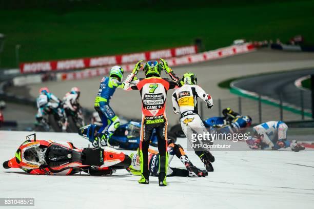 Forward Racing Team's Italian rider Lorenzo Baldassarri reacts after crashing in the first turn after start during the Moto2 Austrian Grand Prix race...