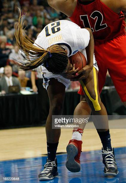 Forward Reshanda Gray of the California Golden Bears pulls the ball away from forward Jasmine Hassell of the Georgia Lady Bulldogs during the NCAA...