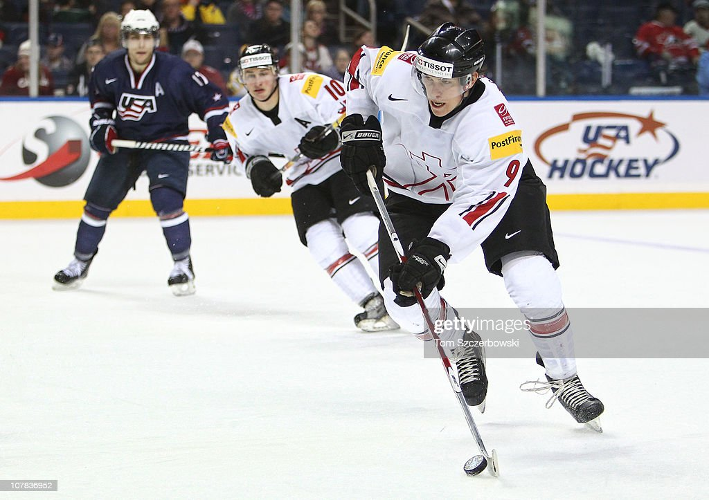 Forward Reto Schappi #9 of Switzerland carries the puck during the 2011 IIHF World U20 Championship game between USA and Switzerland on December 31, 2010 at HSBC Arena in Buffalo, New York.