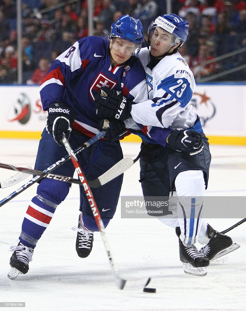 Forward Richard Panik #28 of Slovakia draws a penalty as he tries to get past defenseman Jesse Virtanen #23 of Finland during the 2011 IIHF World U20 Championship game between Slovakia and Finland on December 31, 2010 at HSBC Arena in Buffalo, New York.