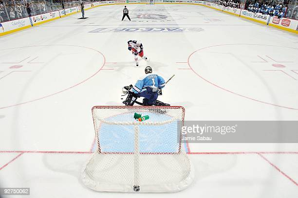 Forward Rick Nash of the Columbus Blue Jackets attempts a shot on goaltender Brent Johnson of the Pittsburgh Penguins during a shootout on October 30...