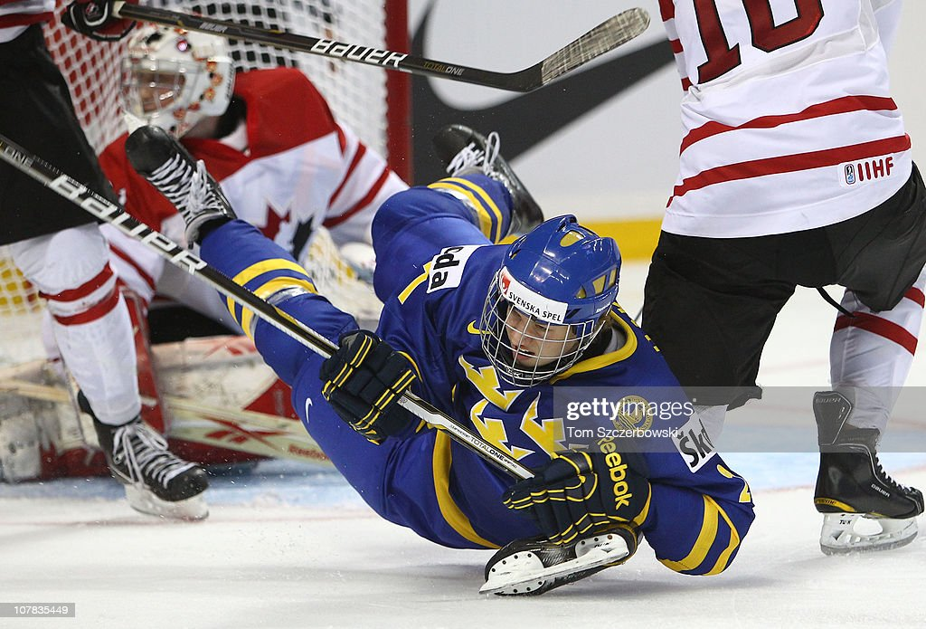 Forward Rickard Rakell #27 of Sweden is dumped to the ice during the 2011 IIHF World U20 Championship game between Canada and Sweden on December 31, 2010 at HSBC Arena in Buffalo, New York.