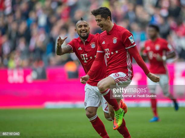Forward Robert Lewandowski of Bayern Muenchen celebrating his goal with Midfielder Arturo Vidal of Bayern Muenchen during the 1 Bundesliga match...