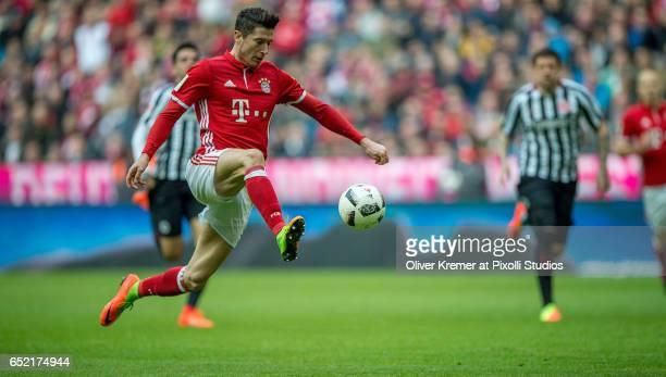 Forward Robert Lewandowski of Bayern Muenchen stopping a pass in full run during the 1 Bundesliga match between FC Bayern Muenchen and Eintracht...