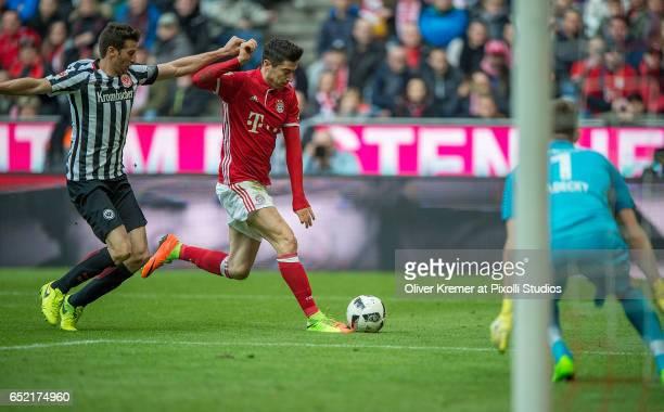 Forward Robert Lewandowski of Bayern Muenchen trying to score during the 1 Bundesliga match between FC Bayern Muenchen and Eintracht Frankfurt at...