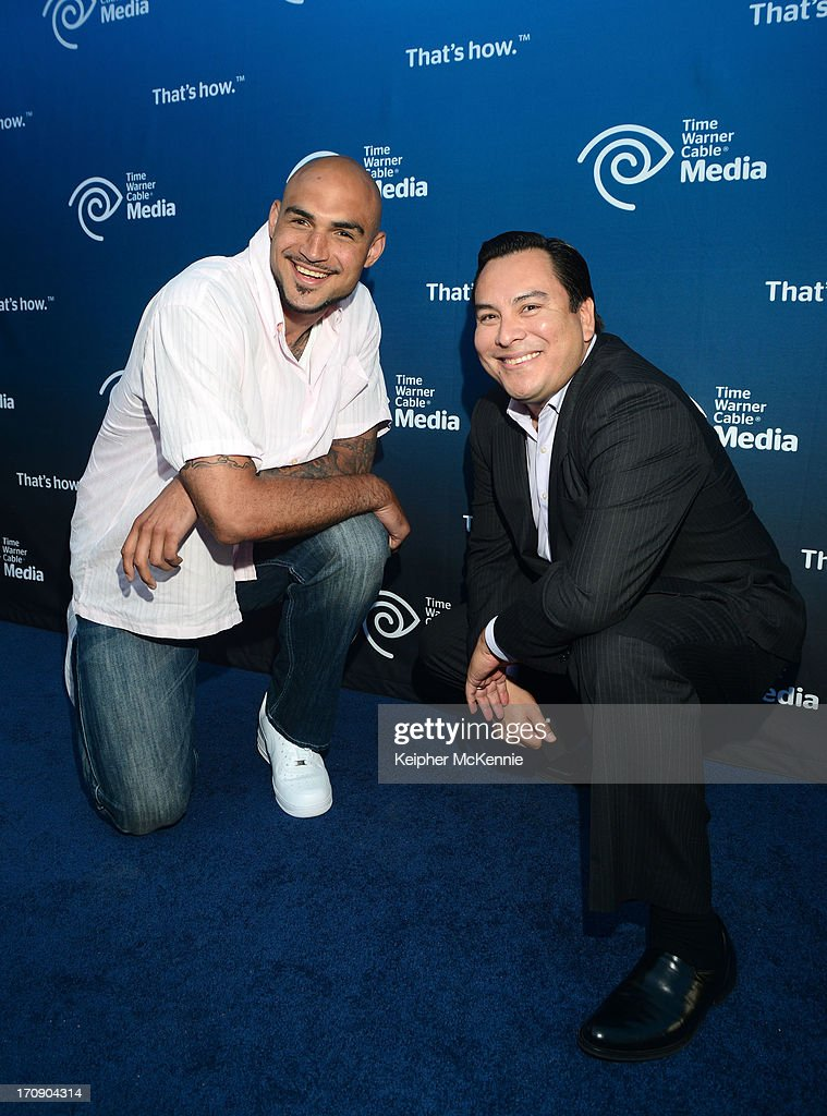 NBA Forward Robert Sacre and TWC Depotes commentator Adrian Garcia Marquez attend Time Warner Cable (TWC Media) 'View From The Top' Upfront honoring LA Lakers' Dr. Jerry Buss at Vibiana on June 19, 2013 in Los Angeles, California. (Photo by Keipher McKennie/WireImage)WireImage)