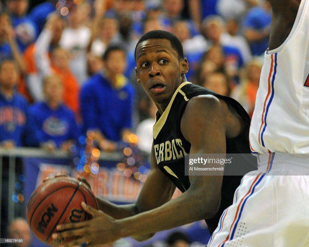 Forward Rod Odom #0 of the Vanderbilt Commodores looks to pass under the basket against the Florida Gators March 6, 2013 at Stephen C. O'Connell Center in Gainesville, Florida.