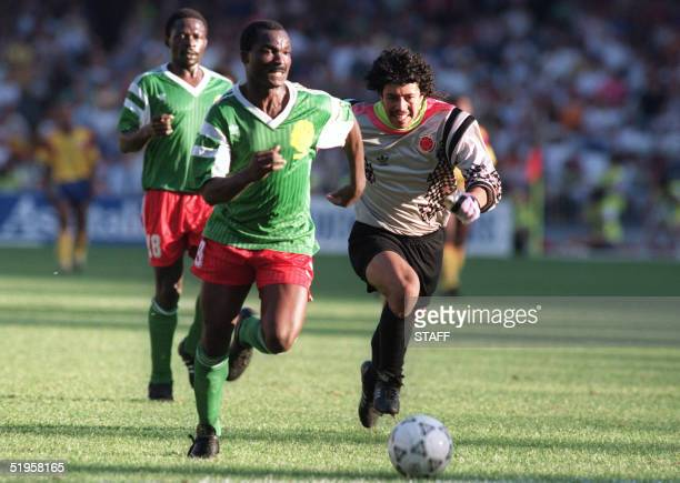 Forward Roger Milla from Cameroon runs past Colombian goalkeeper Jose Higuita after stealing the ball from him on his way to score a goal 23 June...